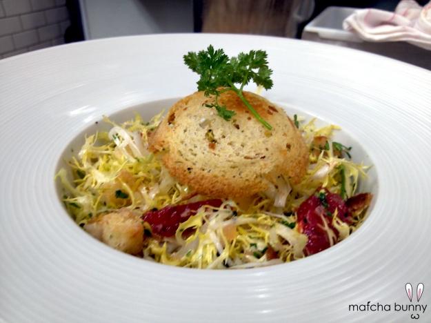 Frisee Salad with Duck Egg, Blood Orange Segments, Truffle Vinaigrette