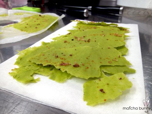Pea puree crackers dusted with powdered Benton's ham and togarashi