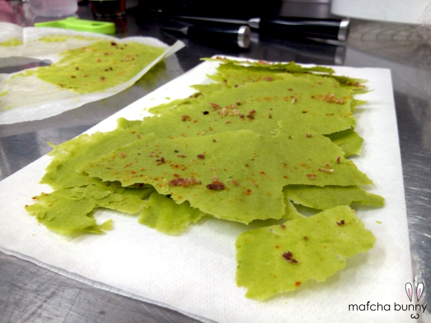 Pea puree crackers dusted with powdered Benton's ham and togarashi