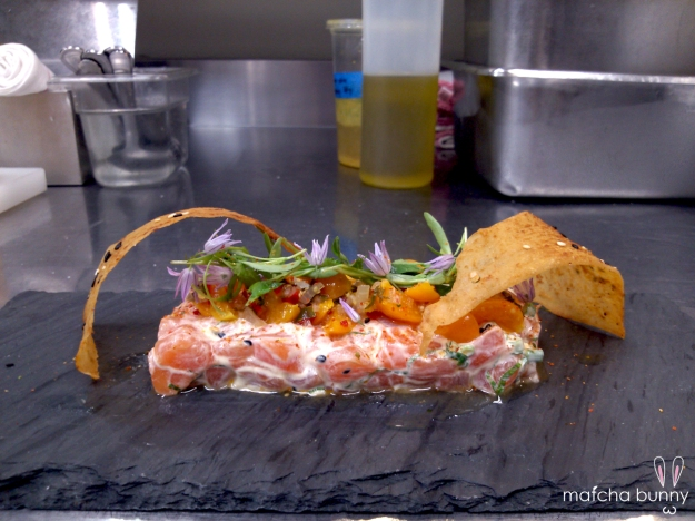 Salmon Poke - salmon, Kewpie mayo dressing, gooseberry salsa, micro cilantro, chive blossoms